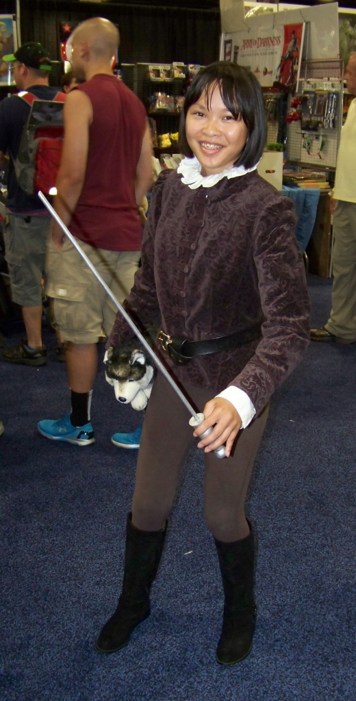Arya Stark, complete with Needle and Nymeria.