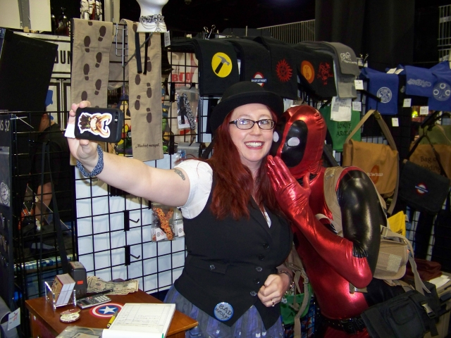 My wife with one of the many Deadpools. Head to storiedthreads.tumblr.com for the full story on their meeting.